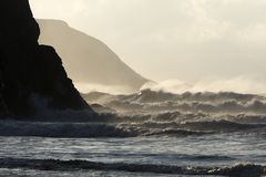 Atlantic waves and North Cornwall cliffs. The cliffs of the North Cornwall coast at Porthtowan on a stormy evening stock photos