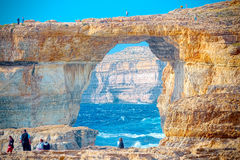 On the cliffs of now collapsed Azur Window, Gozo, Malta. The Azure Window was a 28-metre-tall limestone natural arch on the island of Gozo in Malta, collapsed Stock Photos