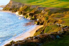 Half Moon Bay beach California Cliffs ocean. Sunlit cliffs beach and golf course in Half Moon Bay California Stock Photography