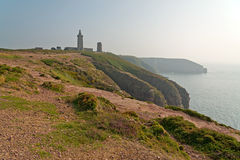 Cliffs with old tower at the Cape of Frehel. Brittany. Royalty Free Stock Photo