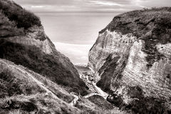 Cliffs Open Valley to the Sea in Normandy France Stock Photo