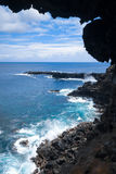 Cliffs and pacific ocean landscape vue from Ana Kakenga cave in. Easter island, Chile stock photo