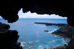 Cliffs and pacific ocean landscape vue from Ana Kakenga cave in. Easter island, Chile stock image