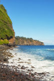 Cliffs and Pacific Ocean from rocky beach Hawaii Stock Image