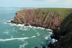 Cliffs on the Pembrokeshire National Path. Vivid red cliffs on the Pembrokeshire National Path, Wales Stock Photography
