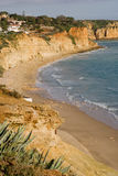 Cliffs of Portugal. The cliffs and beaches of Lagos, in the Algarve, Portugal, with wild Aloe plants in the foreground Royalty Free Stock Photos
