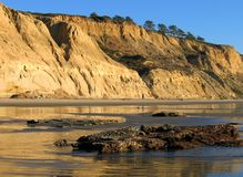 Cliffs with reflections at Torrey Pines State Beach, La Jolla, California stock photography