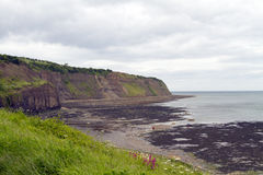 The cliffs at Robin hoods bay. A view across to cliffs at robin hoods bay stock image