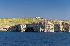 Cliffs of Comino island or Kemmuna in Mediterranean Sea, Malta royalty free stock photography