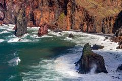 Cliffs and Rocks at St Lawrence in Madeira showing unusual vertical rock formations stock photo