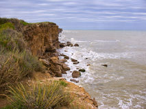 Cliffs on rocky coastline Stock Photo