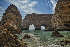Algarve coast. Cliffs and rocky shore in Algarve, Portugal Stock Photo
