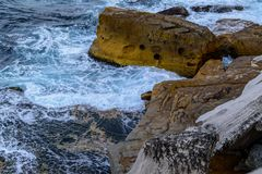 Cliffs and rough sea. Cliffs, waves and rough wild cold sea royalty free stock photography