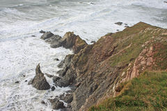 Cliffs in Rough Seas Royalty Free Stock Images