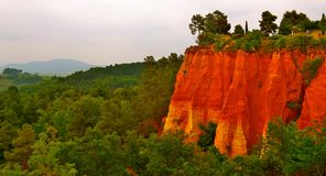 Cliffs of Roussillon, France. The cliffs of ochre surrounding Roussillon, France stock images