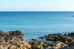 Cliffs and sailing boat, Le Loc'h bay (France) Stock Photo