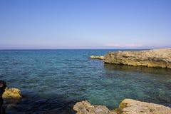 Cliffs of Salento. San Foca coast. Salento seaside. Adriatic coast. The rocks near the shore Stock Image