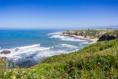 Cliffs and sandy beach on the Pacific Ocean coastline. Near Half Moon Bay, California stock images
