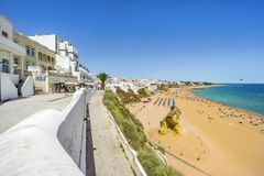 Cliffs, sandy beach and white architecture of Albufeira, Algarve Stock Photography
