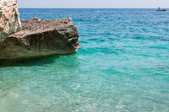 Cliffs in Sardinia Island near Turquoise Sea, Italy Stock Photo