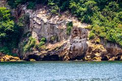 The cliffs of Sarushima from the ferry stock photography