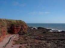 Cliffs in the Scottish Arbroaht. Coastal rock cliffs on the North Sea in the the city of Arbroath in Scotland Stock Photo