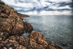 Cliffs by the sea. With dramatic clouds Royalty Free Stock Photos