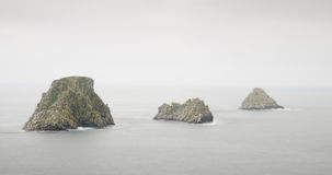 The cliffs and the sea in a foggy or rainy day stock photography