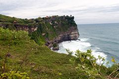 The cliffs and the sea near the Uluwatu Temple Royalty Free Stock Photos