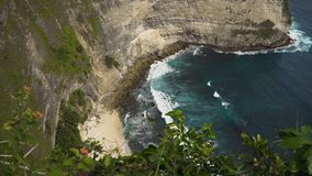 Cliffs, sea and waves at Nusa Penida, Bali, Indonesia. Seascape, rocky coast, with wild beach, ocean, blue sea, waves, Nusa Penida, Indonesia. Ocean with waves Royalty Free Stock Photography