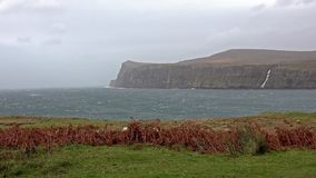 Cliffs seen from Lower Milovaig during the autumn storm Callum - Isle of Skye, Scotland. United Kingdom stock video footage