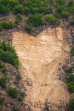 Cliffs in shape of heart Stock Images