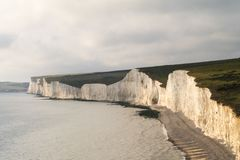 Cliffs and shoreline at Birling Gap. Chalk cliffs and shoreline at Birling Gap, England Stock Images