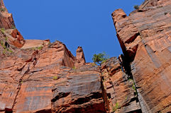 Cliffs and sky. Deep blue sky outlines dark orange pinnacles royalty free stock photo