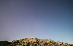 Cliffs and Sky. The cliff face at Mgiebah Bay in Malta, under a starry sky royalty free stock image