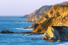 Cliffs on Sopelana coast. At sunset royalty free stock photography