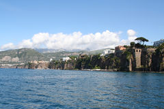 Cliffs of Sorrento, Italy. The cliffs of Sorrento rise out of the beautiful, blue Bay of Naples and attract people on vacation from around the world Royalty Free Stock Images