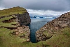 Sorvagsvatn cliffs over the ocean in Faroe Islands