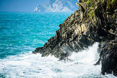 Cliffs in the surf - Cinque Terre coast line Stock Photo