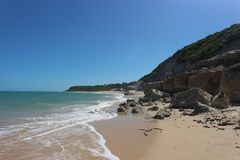 Cliffs in Trancoso`s Espelho Beach, Brazil stock photography
