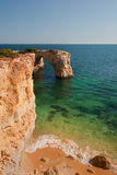 Cliffs and transparent water in Algarve, Portugal, wild beach Royalty Free Stock Photography