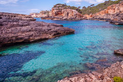 Cliffs and transparent waters. Clean and colored waters in Mediterranean sea royalty free stock image