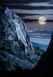 Cliffs of Trascau mountains canyon at night. In full moon light. lovely scenery of Carpathian landscape in springtime. beautiful travel destination. location Stock Image