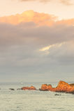 Cliffs under big cloudy sky, Brittany, France Stock Image