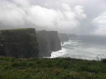 The Cliffs. A walk along the water on a rainy day royalty free stock photo
