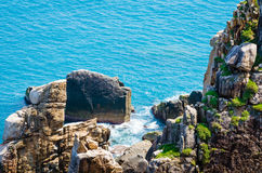 Cliffs and waves, blue deep sea, Dai Lanh Beach Stock Photography