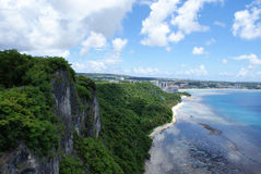 Cliffside at Two Lovers Point in Guam. Taken in Guam looking down at the beach from the top of Two Lovers Point. The rocky cliff walls can be seen going all the Royalty Free Stock Photography