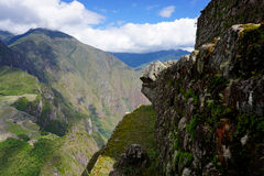 Cliffside View. A beautiful view of ruins and landscape surrounding Machu Picchu in the Andes mountains of Peru, at an altitude of 2,600 meters Stock Image