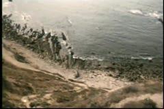 Cliffside view of ocean stock video