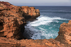 Clift along the Great Ocean Road, Australia. Clift and strong waves along the Great Ocean Road, Australia Royalty Free Stock Images